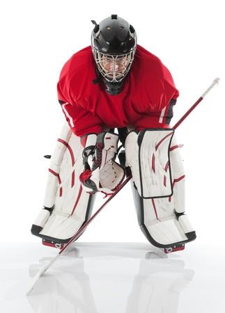 hockey sobre hielo: Portero de hockey sobre hielo. Foto sobre fondo blanco Foto de archivo