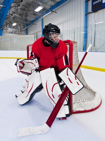 Ice hockey goalie. Picture taken in ice arena. photo