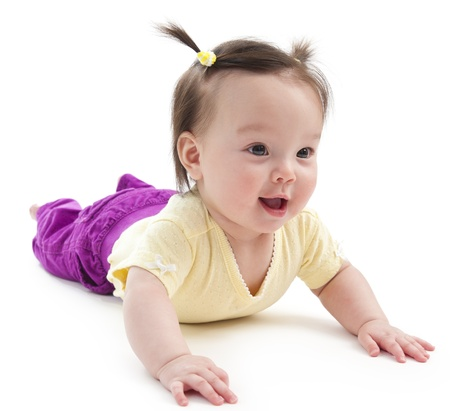 babies laughing: Baby girl on her stomach. Picture on a white background.