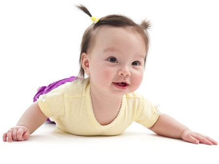 Baby girl smiling posing on her belly. Picture on white background