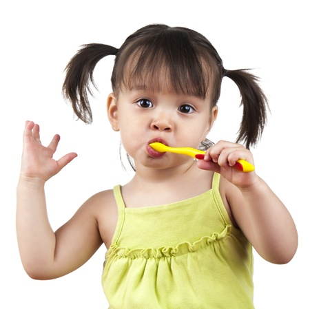 tooth cleaning: Toddler doing dancing moves while brushing her teeth Stock Photo