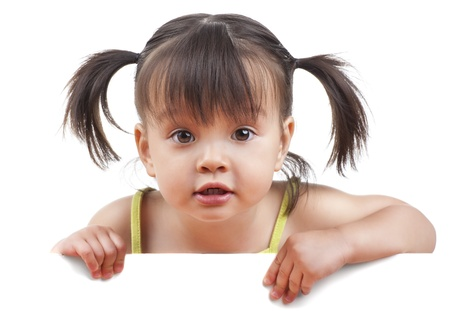 Little girl with white banner looking at camera Stock Photo - 15044247