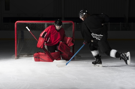 Ice hockey goalie with skater. Picture taken on ice rink arena. Stock Photo