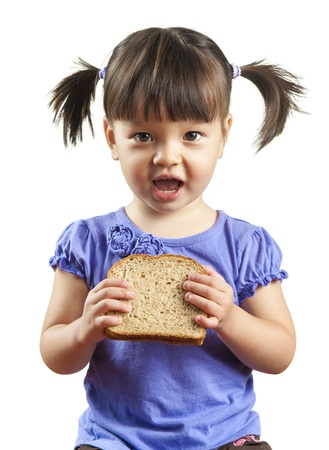 Young child about to eat sandwich. Picture isolated on white background.