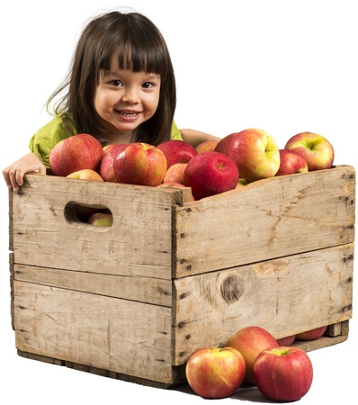 1 year old: Little girl smiling with crate full of apples