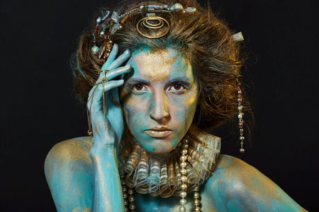 jabot: Model with gold and green body-art