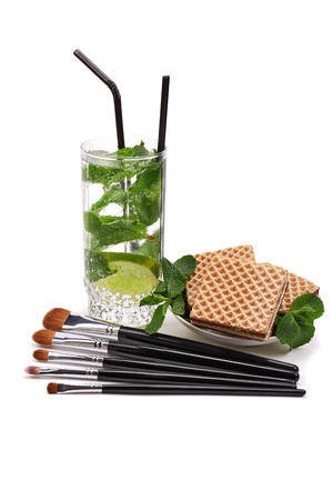grooming product: Makeup brushes set. Mojito. Waffles. Isolated. White background.