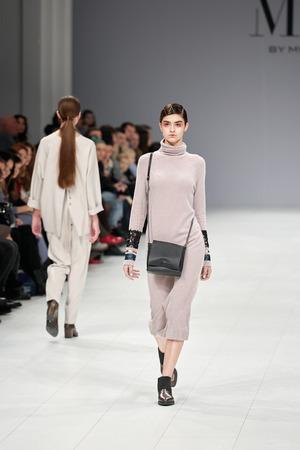 Kyiv, Ukraine - February 5, 2017: Models walk the runway during fashion show MUSI by Musichenko as part of Ukrainian Fashion Week 2017. Editorial
