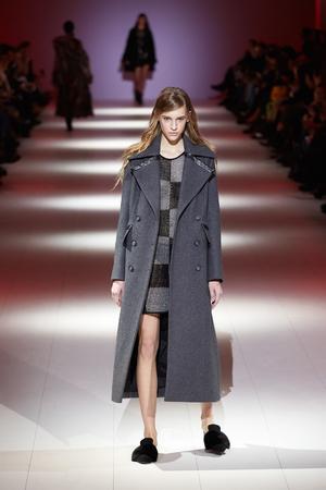 Kyiv, Ukraine - February 6, 2017: Models walk the runway during fashion show by A.M.G. AutumnWinter 201718 as part of Ukrainian Fashion Week 2017. Editorial