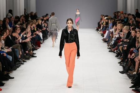Kyiv, Ukraine - February 6, 2017: Models walk the runway during fashion show by Label ONE AutumnWinter 201718 as part of Ukrainian Fashion Week 2017.