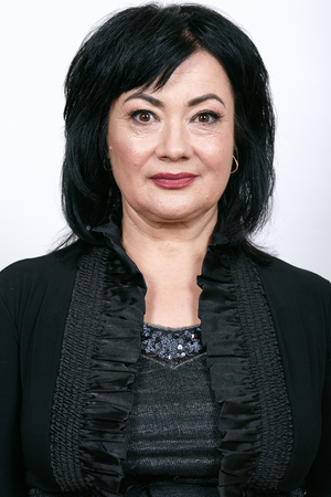 Portrait of mature woman with nude makeup.