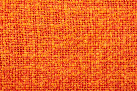 Orange crumpled burlap texture background. Macro of hessian cloth.