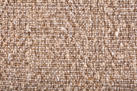 Brown crumpled burlap texture background. Macro of hessian cloth.