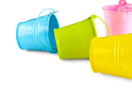 Four small colorful buckets. Isolated on white background. Stockfoto
