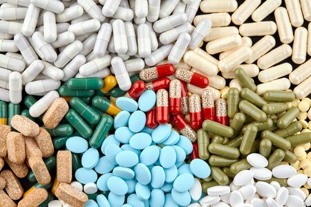 Close-up photo of many colorful pills and capsules.