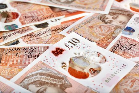 A lot of United Kingdome 10 pounds banknotes. Money horizontal background. Stock Photo