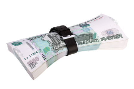 under pressure: bundle russian rubles under pressure  isolated on white with Clipping Path Stock Photo