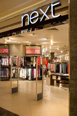 afimall: Moscow, Russia - November 12, 2015: Next Store in  shopping mall Moscow City. Next women and men fashion clothing store, company founded by Joseph Hepworth in Leeds in 1864