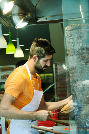 turkish man: Istanbul, Turkey - July 15, 2015: A Turkish man making a Doner kebab in a cafe on Istiklal street