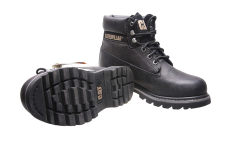 work boots: Black work boots Caterpillar on white background