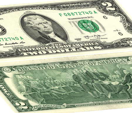 obverse: closeup of the obverse and reverse sides of the banknote in a two dollars isolated on white with Clipping Path. Stock Photo