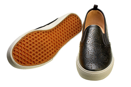 black slip-on casual shoes on white background with Clipping Path