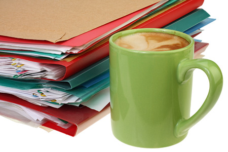 coffee and stack of paper on white background with Clipping Path.