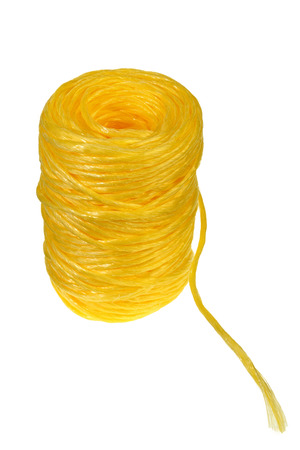 Coil of yellow synthetic rope on white background with Clipping Path.