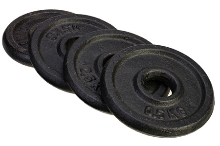 four black metal discs for dumbbells on white background with Clipping Path.