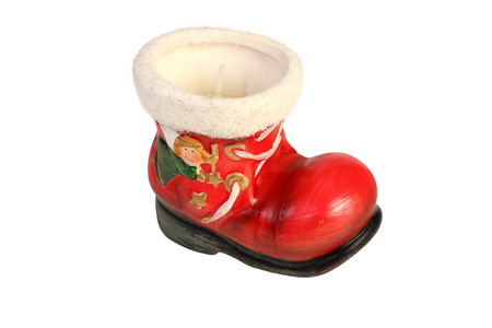 Closeup photo of a red boot-shaped christmas candle on white background with clipping path