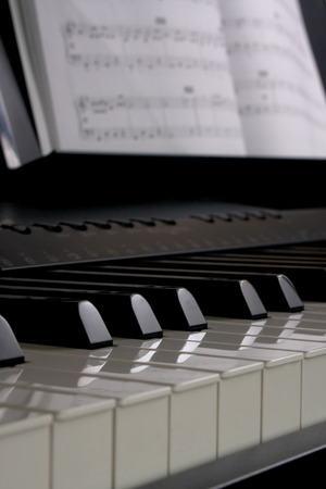sheet music: Piano keys and sheet music Stock Photo