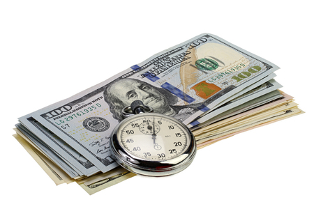 Stopwatch and stack of hundred dollar bills on white background with Clipping path. Reklamní fotografie