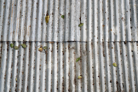 roof tiles: close up rusty old zinc texture background Stock Photo