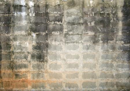 brick road: grunge background, gray brick wall texture bright plaster wall and blocks road sidewalk abandoned exterior urban background Stock Photo