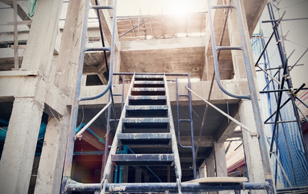 cement pole: Staircase and cement with steel poles for construction Stock Photo