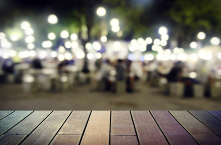 image of wooden table in front of abstract blurred background Stock Photo