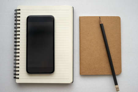 Journal book and smart phone Foto de archivo