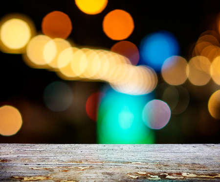 image of wooden table in front of abstract blurred background Banco de Imagens