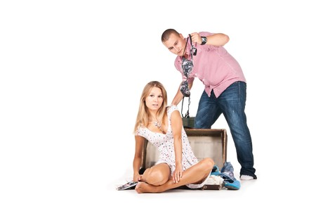 Picture of a young couple  packing their clothes photo