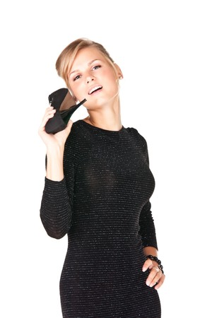 Picture of a girl in black dress with a shoe in her hand photo