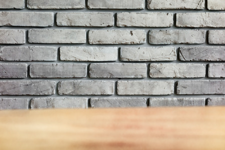 Rule Grey Brick wall with table foreground