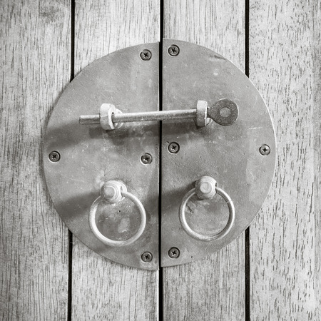Black and white Vintage black Latch on wood  photo