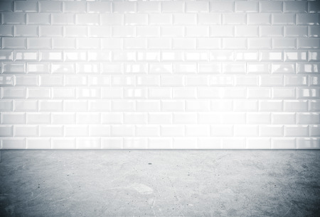 Room perspective-white ceramic tile wall and cement ground photo