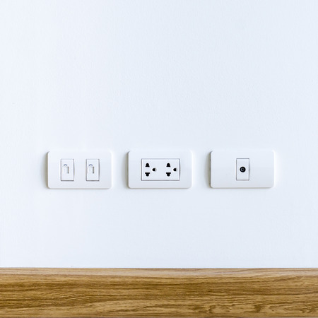 dimmer: Wall Plug for electric city-telephone and cable television Stock Photo