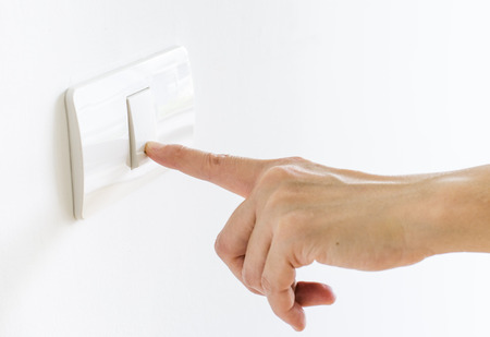 switch: Modern Finger press on light button  Stock Photo