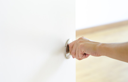 Hand Opening Door Knob White Door Stock Photo   28857275