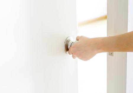 Hand opening door knob-white door photo