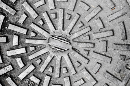 Rustic grunge manhole cover texture background photo