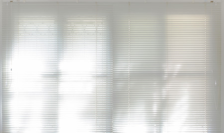 Double window with plastic blind,shade of light photo