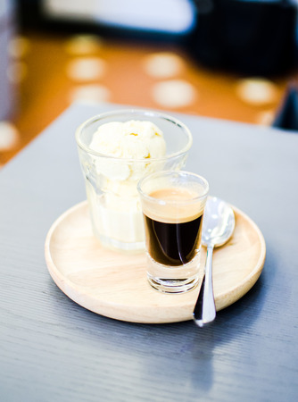 affogato coffee on table in coffee shop photo